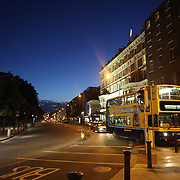 A  Dublin Street Scene at night near St. Stephen's Green showing a public transport bus. Dublin, Ireland. Photo Tim Clayton