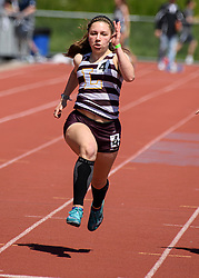 Lebanon junior Claudia Simione charges down the track in the girls 100 meter dash at the NHIAA Division II track and field championship at UNH on Saturday, May 25, 2019.  (Alan MacRae/Valley News)