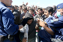 © London News Pictures. © London News Pictures. Hungarian police contain migrants close to the Hungarian and Serbian border town of Roszke, Hungary, September 7 2015. The UN's humanitarian agencies are on the verge of bankruptcy and unable to meet the basic needs of millions of people because of the size of the refugee crisis in the Middle East, Africa and Europe, senior figures within the UN have told the media.   Picture by Paul Hackett /LNP