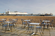 Tables and chairs on Brighton beach, England, United Kingdom
