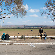Refugees and migrants at the petrol station near Idomani. In the last few months the fields near this petrol station have become a transit camp for thousands of refugees and migrants waiting to cross to Greek Macedonian border.