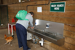Man with learning disability on trip to farm washing his hands