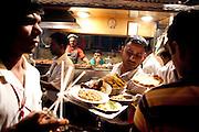Mcc0028781 . Daily Telegraph..Travel..Waiters in the Muslim district of Mumbai near Mohammed Ali road...Mumbai street food..Mumbai January 2011.