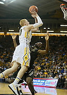 February 27 2013: Iowa Hawkeyes forward Aaron White (30) puts up a shot over Purdue Boilermakers guard Rapheal Davis (35) during the first half of the NCAA basketball game between the Purdue Boilermakers and the Iowa Hawkeyes at Carver-Hawkeye Arena in Iowa City, Iowa on Wednesday, February 27 2013.