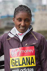 © Licensed to London News Pictures. 18/04/2013. London, England. Pictured: Ethiopian runner Tiki Gelana, gold medal at the 2012 London Olympics. Virgin London Marathon - Photocall with International Women Runners Athletes Tiki Gelana (ETH), Edna Kiplagat (KEN), Priscah Jeptoo (KEN) and Yoko Shibui (JPN) at Tower Bridge ahead of Sunday's run, London. Photo credit: Bettina Strenske/LNP