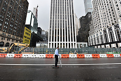 A man heads down 5th Avenue on a scooter as traffic is slowed down near Trump Tower for an Anti-Trump rally during President Donald Trump's first stay in New York City since taking office, New York, NY, on August 15, 2017. (Photo by Anthony Behar)