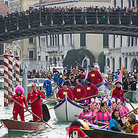 VENICE, ITALY - FEBRUARY 16:  Rowers dressed with  costumes sail under the Accademia Bridge at the traditional regatta on the Grand Canal which officially opens the Venice Carnival on February 16, 2014 in Venice, Italy. The 2014 Carnival of Venice will run from February 15 to March 4 and includes a program of gala dinners, parades, dances, masked balls and music events.  (Photo by Marco Secchi/Getty Images)
