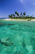 Guanaja, the easternmost of the three Bay Islands, encircled by many kilometers of coral reefs with more than 15 small cays.