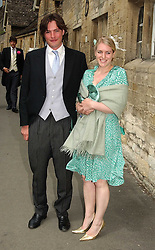 LAURA PARKER BOWLES and MR HARRY LOPEZ at the wedding of Hugh van Cutsem to Rose Astor in Burford, Oxfordshire on 4th June 2005.<br />