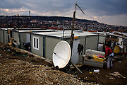 The Mirijevo resettlement camp with new container homes. Doing laundry.
