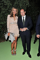 GEORGE & CHRISTIANA GOULANDRIS at a dinner hosted by Cartier in celebration of the Chelsea Flower Show held at Battersea Power Station, 188 Kirtling Street, London SW8 on 23rd May 2011.