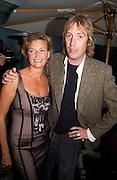 Mr. and Mrs. Rhys Ifans, Evening at Sanderson, 3 June 2003. © Copyright Photograph by Dafydd Jones 66 Stockwell Park Rd. London SW9 0DA Tel 020 7733 0108 www.dafjones.com