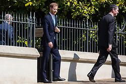 Windsor, UK. 21st April 2019. The Duke of Sussex leaves St George's Chapel in Windsor Castle after attending the Easter Sunday service.