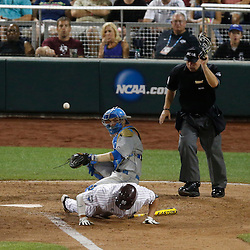Jun 24, 2013; Omaha, NE, USA; Mississippi State Bulldogs right fielder Hunter Renfroe (bottom) is hit by a pitch as UCLA Bruins catcher Shane Zeile (center) and home plate umpire Chris Coskey (top) look on during the eighth inning in game 1 of the College World Series finals at TD Ameritrade Park. Mandatory Credit: Derick E. Hingle-USA TODAY Sports