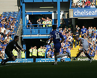 Photo: Lee Earle.<br /> Chelsea v Bolton Wanderers. The Barclays Premiership.<br /> 15/10/2005. Bolton's Stelios Giannakopoulos (R) slots home past Chelsea keeper Petr Cech for their first goal.
