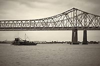 Barge going under Mississippi River Bridge in New Orleans, Louisiana. Image taken with a Nikon D300 and 18-200 mm lens (ISO 200, 50 mm, f/5.6, 1/800 sec). Processed with Capture One Pro (including conversion to B&W).