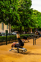 Men exercising in Jardins des Grands Explorateurs, adjacent to the Luxembourg Gardens, Paris, France.
