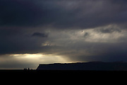 A storm approaches over Vík in southern Iceland