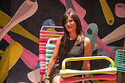 A representative from Foam Creations sits in an outdoor chair with colorful foam upholstery, a polyikefin foam.