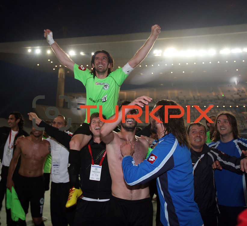 Konyaspor's players Omer HACISALIHOGLU (B) celebrates victory during their Turkish soccer Play Off final match Altayspor between Konyaspor at Ataturk Olympic Stadium in Istanbul Turkey on Sunday, 23 May 2010. Photo by TURKPIX