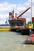 Sloman Discharger cargo ship at dockside, Harwich, Essex, England, UK