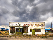 Abandon town garage sits idle in Leadore, Idaho adding to the mistique of the pending storm.