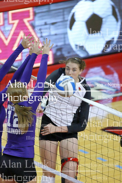 07 September 2011: Ciera Lucich handles the hit at the net during an NCAA volleyball match between the Leathernecks of Western Illinois  and the Illinois State Redbirds at Redbird Arena in Normal Illinois.