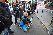 A local with his dog photographs the damage. Cafe Bonne Biere, Rue Fontaine au Roi, near Republique<br /><br />The Day after the terrorist jihadi attacks. Bullet holes and blood, mourning homage and cleaning up. Aftermath of deadly Paris terrorist attacks. Saturday 14th November 2015<br /> <br /> Eight terrorists dead and some 128 people killed at Stade de France, Bataclan concert Hall, Belle Equipe Restaiurant, Rue Fontaine au Roi, Two hundred people have been injured, 80 of them seriously.