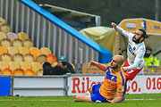 Sam Deering (7) of Dagenham & Redbridge  gets a shot away during the The FA Cup match between Mansfield Town and Dagenham and Redbridge at the One Call Stadium, Mansfield, England on 29 November 2020.