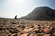 Israel, Negev desert, Lone woman meditating