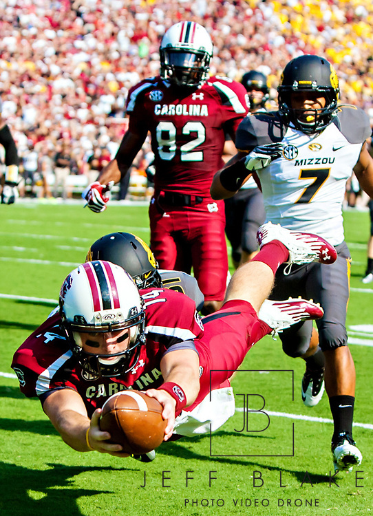 South Carolina Gamecocks quarterback Connor Shaw (14) dives over the goal line as Missouri Tigers defensive back Randy Ponder pursues in the first quarter at Williams-Brice Stadium. The run was called back due to penalty. Photo by Columbia, SC, photojournalist Jeff Blake