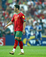 Fotball<br /> EURO 2004<br /> Portugal<br /> 12.06.2004<br /> NORWAY ONLY<br /> <br /> Hellas v Portugal<br /> <br /> Foto: Scott Heavey/Digitalsport<br /> <br /> Christiano Ronaldo walks away as Greece celebrate the penalty that he gave away