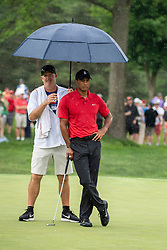 June 3, 2018 - Dublin, OH, U.S. - DUBLIN, OH - JUNE 03:  Tiger Woods is protected from a brief rain shower by his caddy during the final round of the Memorial Tournament at Muirfield Village Golf Club in Dublin, Ohio on June 03, 2018. (Photo by Shelley Lipton/Icon Sportswire) (Credit Image: © Shelley Lipton/Icon SMI via ZUMA Press)