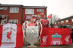 Emily Farley and her son David outside her home in Higham Square, Liverpool, which is decked out in Liverpool Football Club flags ahead of the UEFA Champions League final.