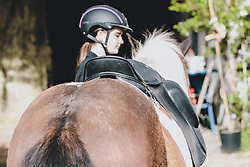 THEMENBILD - eine junge Frau mit ihrem Pferd (Isländer) im Reitstall. Reitställe und Gestüte dürfen ab heute nach dem Lock Down wieder öffnen und Reiten ist wieder erlaubt, aufgenommen am 01. Mai 2020 in Kaprun, Oesterreich // a young woman with her horse (Icelander) in the riding stable. Riding stables and studs may reopen after the lock down and riding is allowed again in Kaprun, Austria on 2020/05/01, Kaprun, Austria. EXPA Pictures © 2020, PhotoCredit: EXPA/ Stefanie Oberhauser
