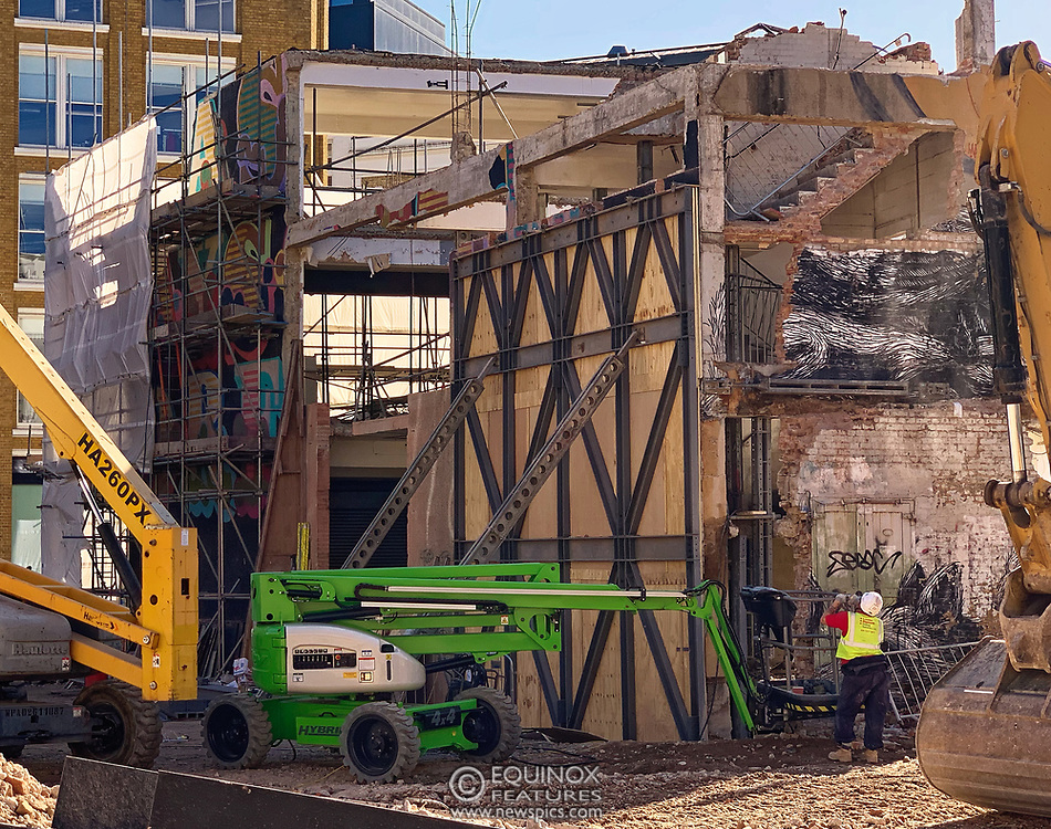 London, United Kingdom - 17 September 2019<br /> EXCLUSIVE SET - Aerial construction specialists and demolition experts use a huge crane to carefully lift intact, a twenty five ton, two-story wall, to preserve a famous Banksy rat image which has been covered up for years. Teams from specialist companies have spent over six weeks cutting around the artwork and fitting custom made eight ton steel supports to enable them to save the historic piece of art. Work has started on the construction of a new twenty seven floor art'otel hotel on the site of the old Foundry building in Shoreditch, east London, and a condition of the planning permission was to preserve the historical Banksy graffiti. A second section of the painting, an image of a TV being thrown through a broken window has already been cut out and moved separately. After the hotel construction is complete the two parts of the Banksy painting will be displayed on the hotel. Our pictures show the stages of work to protect the image, culminating in the lifting of the three story wall by crane. Video footage also available.<br /> (photo by: EQUINOXFEATURES.COM)<br /> Picture Data:<br /> Photographer: Equinox Features<br /> Copyright: ©2019 Equinox Licensing Ltd. +443700 780000<br /> Contact: Equinox Features<br /> Date Taken: 20190917<br /> Time Taken: 154032<br /> www.newspics.com
