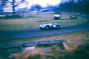 """British Sports racing driver Bill de Selincourt (1921-2014) driving Lister-Jaguar """" Knobbly"""" car, BARC event at Oulton Park circuit, Cheshire, England 17th March 1962"""