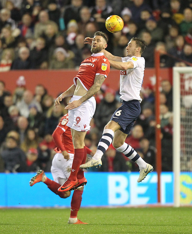 Preston North End's Ben Davies jumps with Nottingham Forest's Daryl Murphy<br /> <br /> Photographer Mick Walker/CameraSport<br /> <br /> The EFL Sky Bet Championship - Nottingham Forest v Preston North End - Saturday 8th December 2018 - The City Ground - Nottingham<br /> <br /> World Copyright © 2018 CameraSport. All rights reserved. 43 Linden Ave. Countesthorpe. Leicester. England. LE8 5PG - Tel: +44 (0) 116 277 4147 - admin@camerasport.com - www.camerasport.com