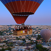 Tourists in hot air balloon fly close in Cappadocia, Turkey