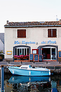 The old harbour. La Taverne du Port with many chalkboards with menus. Marseillan. Languedoc. France. Europe.