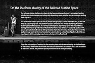 The railroad station platform is a place of dual personalities and roles. It occupies a familiar role, but one that changes psychologically depending upon whether one is starting or ending their day on it.<br /> <br /> The platform is both a space to wait at, and to exit quickly. It carries either the first, or the last steps of a journey by rail. The platform space is temporal and always in change; it can be a bustling people filled space, or a lonely isolated place, depending upon the day and hour. Some platforms are grand and comfortable for their users; others are bare and spartan with just an unheated windbreak to offer protection from the elements. No matter how novel the platform may seem to the new traveler, for a commuter on a ritual travel pattern, it will be as much a part of the workday experience as being in the office itself. <br /> <br /> From the anticipation of waiting for the morning train with its warm interior to the loneliness of the solitary walk home in the dark and cold, the platform is in constant flux. Just as sudden as the train's arrival, the platform quickly transforms to its next personality.