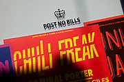 Post No Bills sign is totally ignored on a building in London as posters for music concerts covers the are in defiance.