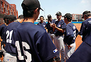 Coach Yaris gives his Blue Stars players a talk after they played against a Chinese university team in an exhibition game at a summer training camp run by Major League Baseball Wuxi, China, on 19 August, 2010.  Targeting teenagers between the ade of 12-15, the league hopes to use the camp to groom potential baseball talent in China and in the long term increase the popularity of the sport in the world's most populous country.
