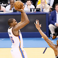 08 May 2016: Oklahoma City Thunder forward Kevin Durant (35) takes a jump shot over San Antonio Spurs forward David West (30) during the Oklahoma City Thunder 111-97 victory over the San Antonio Spurs, during Game Four of the Western Conference Semifinals of the NBA Playoffs at the Chesapeake Energy Arena, Oklahoma City, Oklahoma, USA.