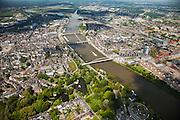 Nederland, Limburg, Gemeente Maastricht, 27-05-2013; <br /> Overzicht Maastricht met Maas. Links de historische binnenstad het Vrijhof, midden beneden het Stadspark  en bruggen over de rivier, beneden in beeld een deel van de verkeersbrug John F. Kennedybrug (N278) over de rivier de Maas, de Hoge Brug, de Sint Servaasbrug, de Wilhelminabrug, een spoorbrug en als laatste de Noorderbrug  Op de rechteroever de nieuwe wijk Ceramique en stadsdeel Wyck.<br /> View on the old town of Maastricht (left) and the bridges  on the river Maar (Meuse).<br /> Bottom pic the John F. Kennedy Bridge (N278). On the right bank the new constructuted district Ceramique.<br /> luchtfoto (toeslag op standaardtarieven);<br /> aerial photo (additional fee required);<br /> copyright foto/photo Siebe Swart.