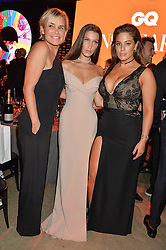 Left to right, YOLANDA HADID, BELLA HADID, and ASHLEY GRAHAM at the GQ Men of The Year Awards 2016 in association with Hugo Boss held at Tate Modern, London on 6th September 2016.
