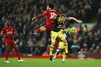 Football - 2019 / 2020 Premier League - Liverpool vs. Southampton<br /> <br /> Liverpool's Takumi Minamino battles with Southampton's James Ward-Prowse<br /> <br /> Colorsport / Terry Donnelly