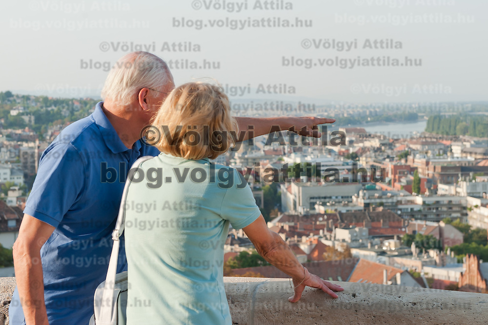 Tourists enjoy the view on a summer sightseeing from the castle of Buda in Budapest, Hungary on August 25, 2011. ATTILA VOLGYI