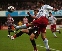 Photo: Tony Oudot.<br /> Brentford v Lincoln City. Coca Cola League 2. 27/10/2007.<br /> Gary Croft of Lincoln clears from Craig Pead of Brentford