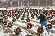 Goshen, New York - A man walks through Orange County Veterans Memorial Cemetery at the end of a Wreaths Across America ceremony on Dec. 16, 2017. About 3,000 wreaths were placed at graves, and small American flags were added to the wreaths at veterans' graves.